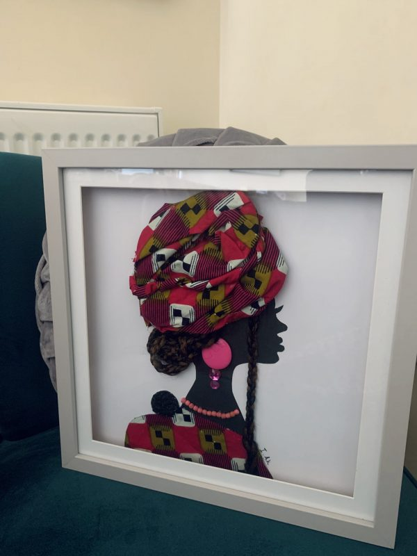 Collage of African woman with baby on back and headtie - framed